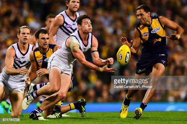 Lachie Neale of the Dockers handpasses the ball during the 2017 AFL round 06 match between the West Coast Eagles and the Fremantle Dockers at Domain...