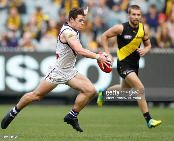 Lachie Neale of the Dockers in his 100th game breaks away to kick the ball into the 50 with seconds remaining during the 2017 AFL round 08 match...