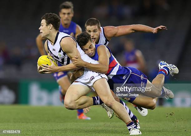 Lachie Neale of the Dockers is tackled by Luke Dahlhaus of the Bulldogs during the round three AFL NAB Challenge match between the Western Bulldogs...