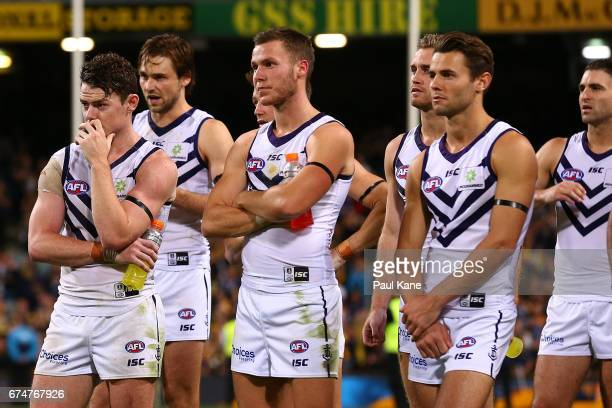 Lachie Neale of the Dockers looks on with team mates after being defeated during the round six AFL match between the West Coast Eagles and the...
