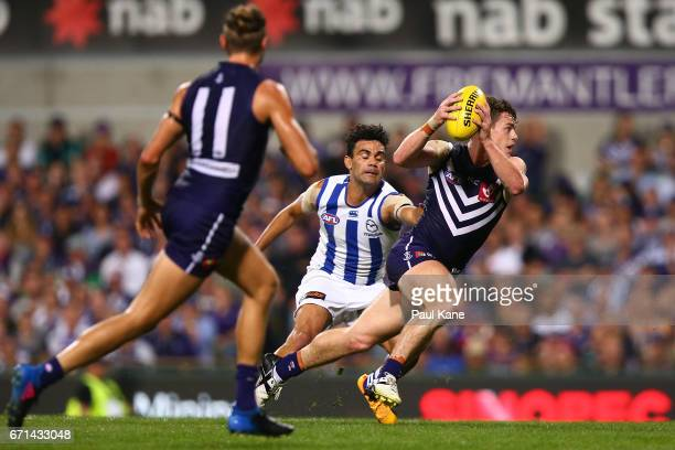 Lachie Neale of the Dockers looks to avoide being tackled during the round five AFL match between the Fremantle Dockers and the North Melbourne...