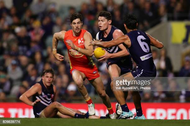 Lachie Neale of the Dockers looks to pass the ball during the round 20 AFL match between the Fremantle Dockers and the Gold Coast Suns at Domain...