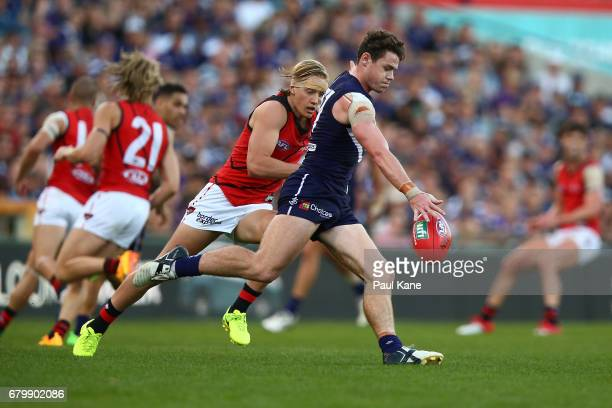 Lachie Neale of the Dockers passes the ball during the round seven AFL match between the Fremantle Dockers and the Essendon Bombers at Domain Stadium...