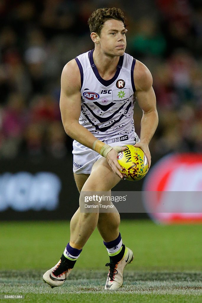 Lachie Neale of the Dockers runs with the ball during the round 10 AFL match between the St Kilda Saints and the Fremantle Dockers at Etihad Stadium on May 28, 2016 in Melbourne, Australia.