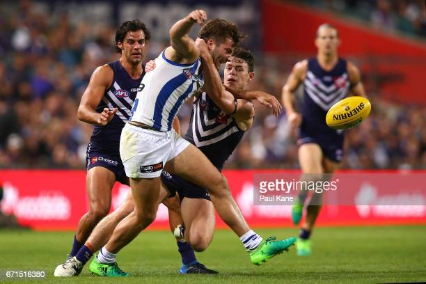 Lachie Neale of the Dockers tackles Luke McDonald of the Kangaroos high during the round five AFL match between the Fremantle Dockers and the North...