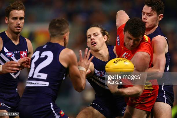 Lachie Neale of the Dockers tackles Pearce Hanley of the Suns during the round 20 AFL match between the Fremantle Dockers and the Gold Coast Suns at...