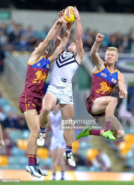 Lachie Neale of the Dockers takes a mark during the round 12 AFL match between the Brisbane Lions and the Fremantle Dockers at The Gabba on June 10...