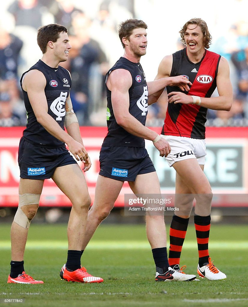 Lachie Plowman (left) and Sam Rowe of the Blues chat to Joe Daniher of the Bombers as he disputes a 50 metre penalty during the 2016 AFL Round 06 match between the Carlton Blues and the Essendon Bombers at the Melbourne Cricket Ground, Melbourne on May 1, 2016.