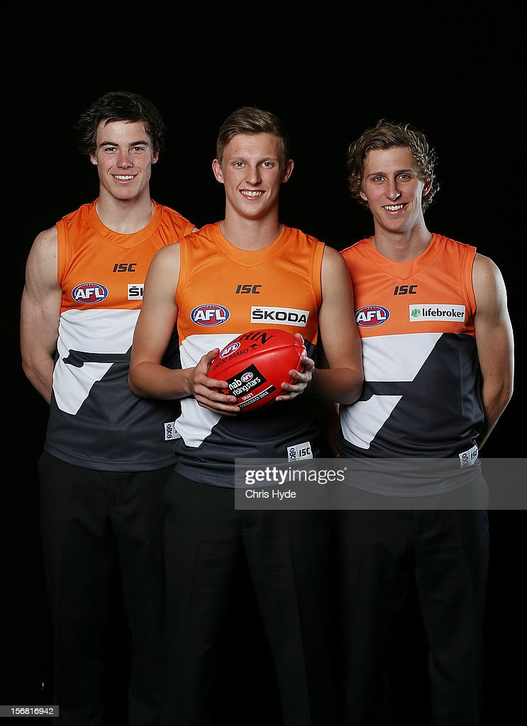 Lachie Plowman, Lachie Whitfield and Jonathan O'Rouke pose with GWS jersey during the 2012 AFL Draft at the Gold Coast Exhibition Centre on November 22, 2012 on the Gold Coast, Australia.