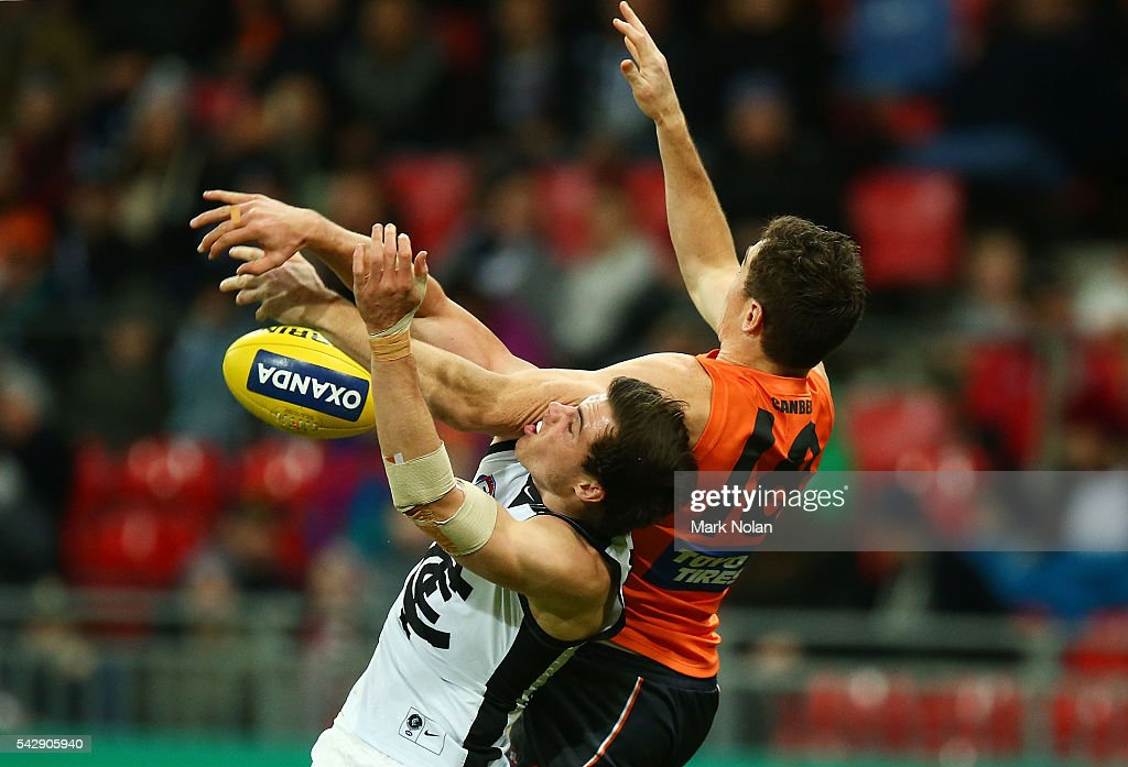 Lachie Plowman of Carlton and Jeremy Cameron of the Giants contest possession during the round 14 AFL match between the Greater Western Sydney Giants and the Carlton Blues at Spotless Stadium on June 25, 2016 in Sydney, Australia.