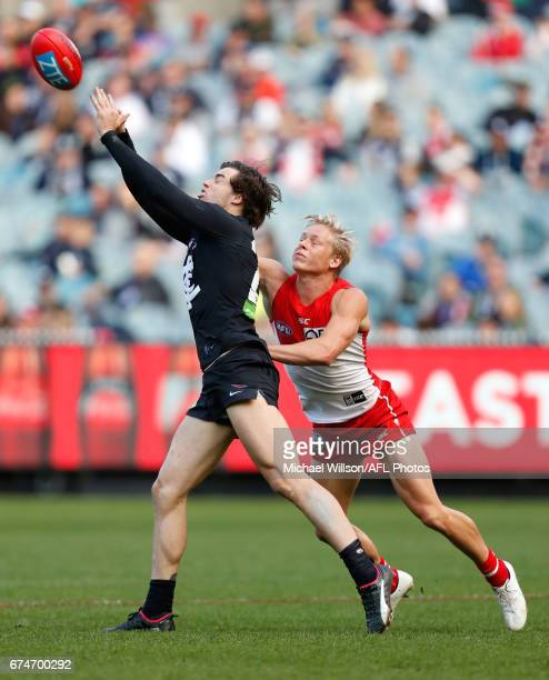 Lachie Plowman of the Blues and Isaac Heeney of the Swans compete for the ball during the 2017 AFL round 06 match between the Carlton Blues and the...