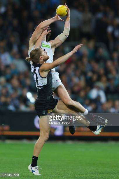 Lachie Plowman of the Blues marks the ball over Aaron Young of the Power during the round five AFL match between the Port Adelaide Power and thew...