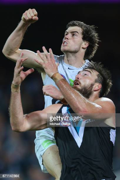 Lachie Plowman of the Blues punches the ball over Charlie Dixon of the Power during the round five AFL match between the Port Adelaide Power and thew...
