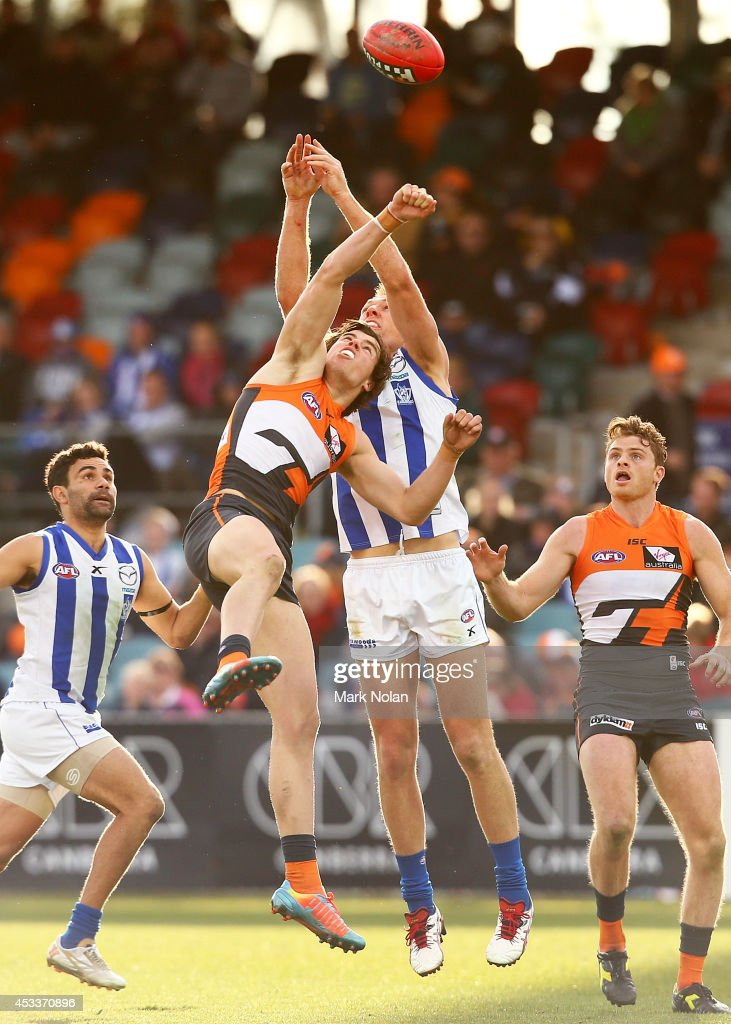 Lachie Plowman of the Giants and <a gi-track='captionPersonalityLinkClicked' href=/galleries/search?phrase=Drew+Petrie&family=editorial&specificpeople=216448 ng-click='$event.stopPropagation()'>Drew Petrie</a> of the Kangaroos contest a mark during the round 20 AFL match between the Greater Western Sydney Giants and the North Melbourne Kangaroos at Stratrack Oval on August 9, 2014 in Canberra, Australia.
