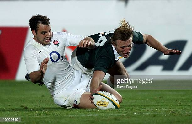 Lachie Turner of the Australian Barbarians beats Olly Barkley to the ball during the match between the Australian Barbarians and England at on June...