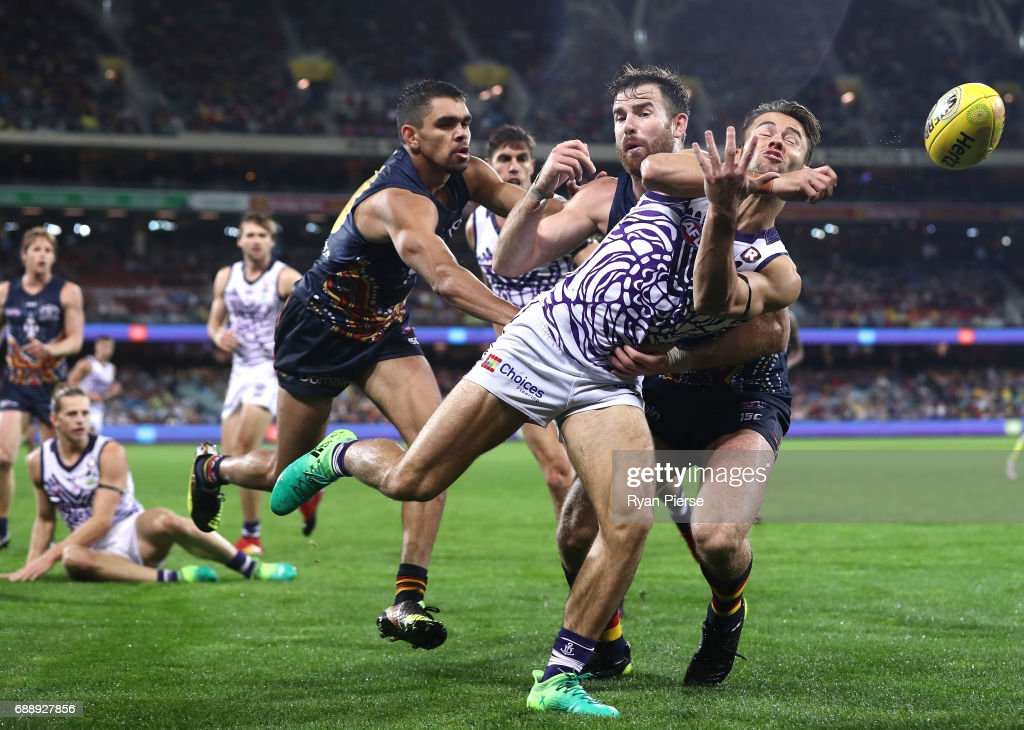 Lachie Weller of the Dockers is tackled by Andy Otten of the Crows during the round 10 AFL match between the Adelaide Crows and the Fremantle Dockers at Adelaide Oval on May 27, 2017 in Adelaide, Australia.