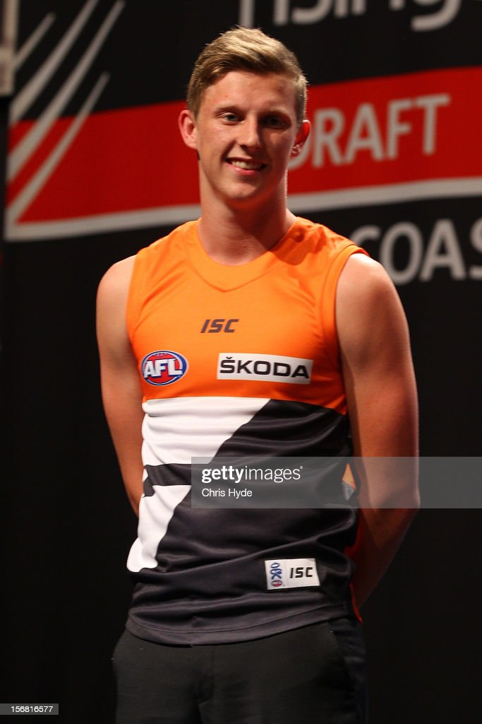 Lachie Whitfield is presented with GWS jersey during the 2012 AFL Draft at the Gold Coast Exhibition Centre on November 22, 2012 on the Gold Coast, Australia.