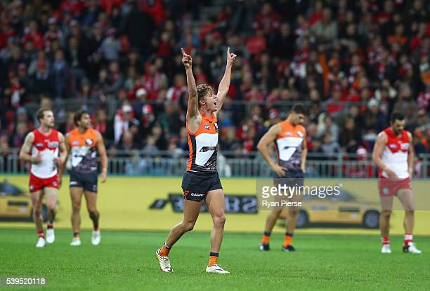 Lachie Whitfield of the Giants celebrates a goal during the round 12 AFL match between the Greater Western Sydney Giants and the Sydney Swans at...