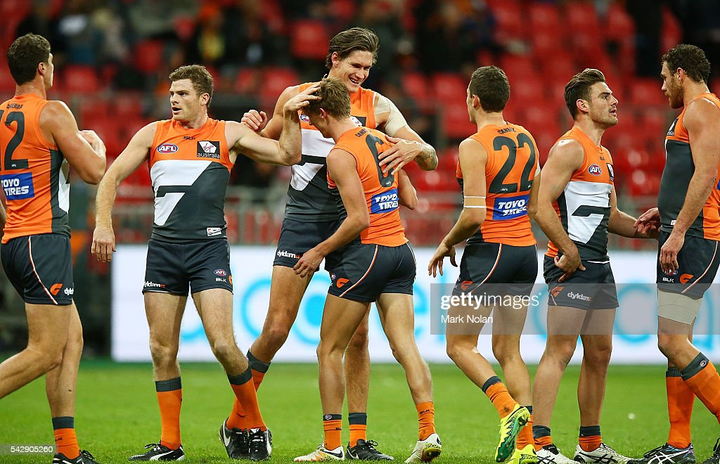 <a gi-track='captionPersonalityLinkClicked' href=/galleries/search?phrase=Lachie+Whitfield&family=editorial&specificpeople=7917185 ng-click='$event.stopPropagation()'>Lachie Whitfield</a> of the Giants celebrates a goal with team mates during the round 14 AFL match between the Greater Western Sydney Giants and the Carlton Blues at Spotless Stadium on June 25, 2016 in Sydney, Australia.