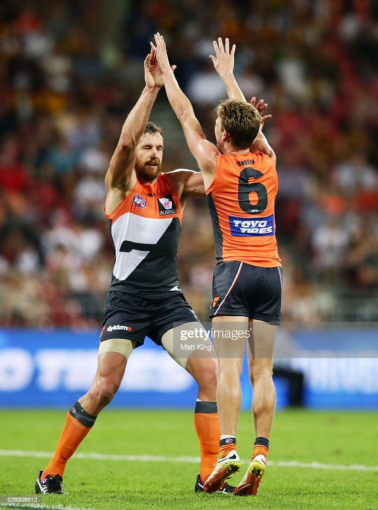 <a gi-track='captionPersonalityLinkClicked' href=/galleries/search?phrase=Lachie+Whitfield&family=editorial&specificpeople=7917185 ng-click='$event.stopPropagation()'>Lachie Whitfield</a> of the Giants (R) celebrates with Shane Mumford of the Giants (L) after kicking a goal during the round six AFL match between the Greater Western Sydney Giants and the Hawthorn Hawks at Spotless Stadium on April 30, 2016 in Sydney, Australia.