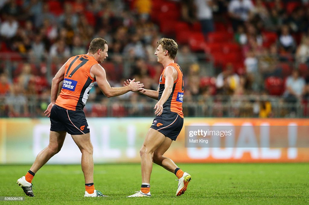 <a gi-track='captionPersonalityLinkClicked' href=/galleries/search?phrase=Lachie+Whitfield&family=editorial&specificpeople=7917185 ng-click='$event.stopPropagation()'>Lachie Whitfield</a> of the Giants (R) celebrates with <a gi-track='captionPersonalityLinkClicked' href=/galleries/search?phrase=Steve+Johnson+-+Australian+Rules+Footballer&family=editorial&specificpeople=11430122 ng-click='$event.stopPropagation()'>Steve Johnson</a> of the Giants (L) after kicking a goal during the round six AFL match between the Greater Western Sydney Giants and the Hawthorn Hawks at Spotless Stadium on April 30, 2016 in Sydney, Australia.
