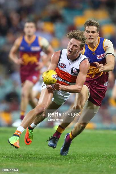 Lachie Whitfield of the Giants handballs during the round 14 AFL match between the Brisbane Lions and the Greater Western Sydney Giants at The Gabba...