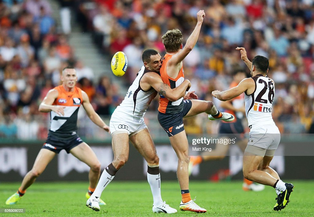 <a gi-track='captionPersonalityLinkClicked' href=/galleries/search?phrase=Lachie+Whitfield&family=editorial&specificpeople=7917185 ng-click='$event.stopPropagation()'>Lachie Whitfield</a> of the Giants is tackled by <a gi-track='captionPersonalityLinkClicked' href=/galleries/search?phrase=Shaun+Burgoyne&family=editorial&specificpeople=224566 ng-click='$event.stopPropagation()'>Shaun Burgoyne</a> of the Hawks during the round six AFL match between the Greater Western Sydney Giants and the Hawthorn Hawks at Spotless Stadium on April 30, 2016 in Sydney, Australia.