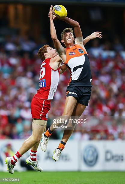 Lachie Whitfield of the Giants takes a mark under pressure from Gary Rohan of the Swans during the round three AFL match between the Sydney Swans and...