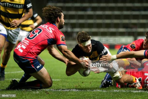 Lachlan Boshier of Taranaki scores a try under pressure from Billy Guyton of Tasman during the round seven Mitre 10 Cup match between Taranaki and...