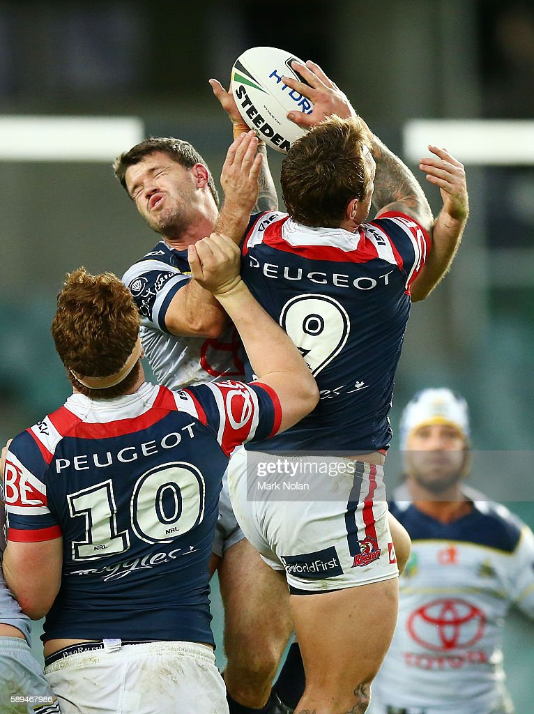 Lachlan Coote of the Cowboys and Jake Friend of the Roosters contest a high ball during the round 23 NRL match between the Sydney Roosters and the North Queensland Cowboys at Allianz Stadium on August 14, 2016 in Sydney, Australia.