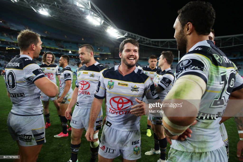 Lachlan Coote of the Cowboys and team mates celebrate victory at the end of the NRL Semi Final match between the Parramatta Eels and the North Queensland Cowboys at ANZ Stadium on September 16, 2017 in Sydney, Australia.