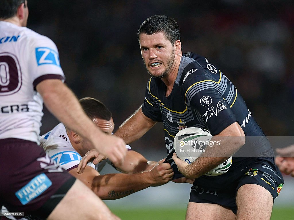 Lachlan Coote of the Cowboys looks to break the Sea Eagles defence during the round 16 NRL match between the North Queensland Cowboys and the Manly Sea Eagles at 1300SMILES Stadium on June 27, 2016 in Townsville, Australia.
