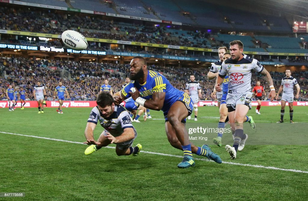Lachlan Coote of the Cowboys punches the ball awat from Semi Radradra of the Eels during the NRL Semi Final match between the Parramatta Eels and the North Queensland Cowboys at ANZ Stadium on September 16, 2017 in Sydney, Australia.