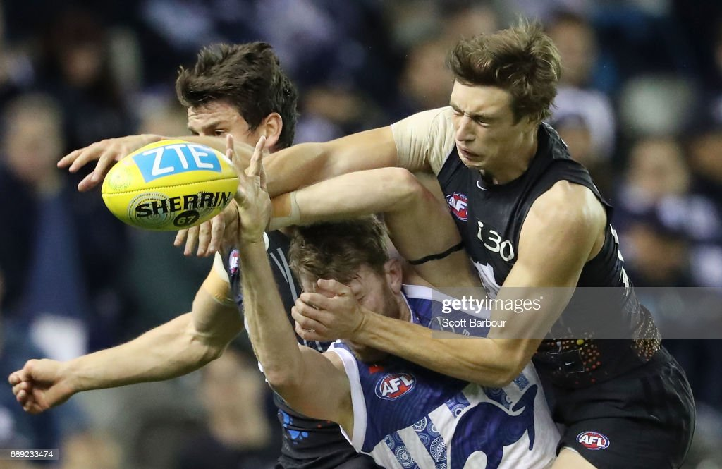 Lachlan Hansen of the Kangaroos and Caleb Marchbank of the Blues compete for the ball during the round 10 AFL match between the Carlton Blues and the North Melbourne Kangaroos at Etihad Stadium on May 28, 2017 in Melbourne, Australia.