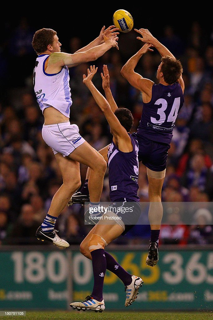 Lachlan Hansen of the Kangaroos and Lee Spurr of the Dockers contest the ball during the round 22 AFL match between the North Melbourne Kangaroos and the Fremantle Dockers at Etihad Stadium on August 26, 2012 in Melbourne, Australia.