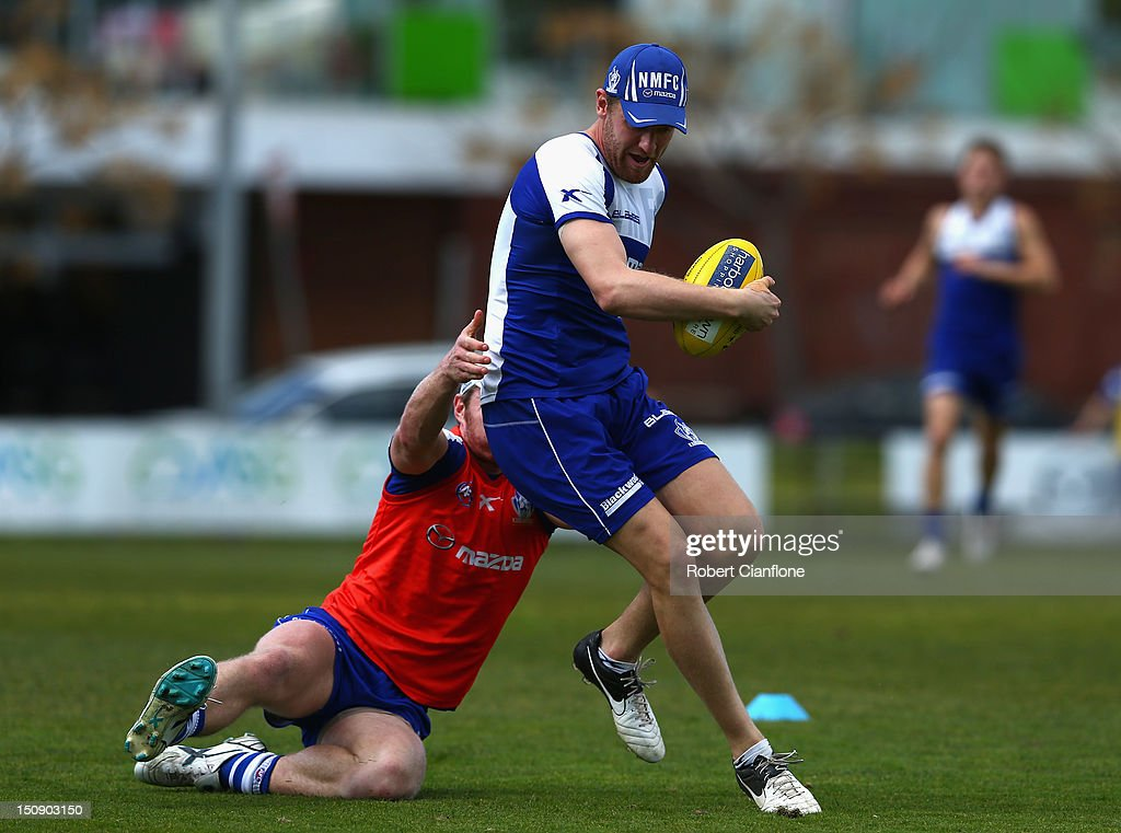 Lachlan Hansen of the Kangaroos is challenged by Brad Mangan during a training session at Aegis Park on August 29, 2012 in Melbourne, Australia.