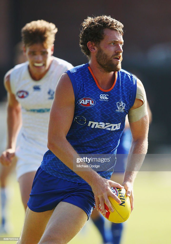 Lachlan Hansen of the Kangaroos looks upfield during the North Melbourne AFL Intra-Club match at Arden Street Ground on February 12, 2016 in Melbourne, Australia.