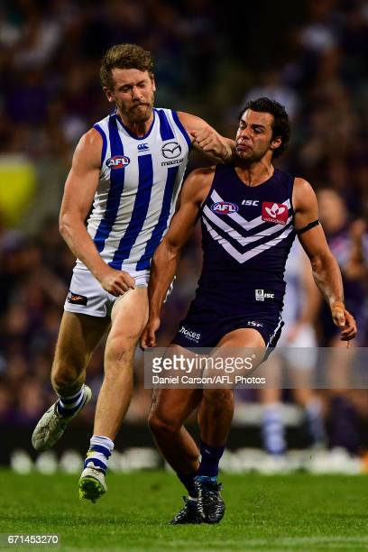 Lachlan Hansen of the Kangaroos makes high contact with Brady Grey of the Dockers during the 2017 AFL round 05 match between the Fremantle Dockers...