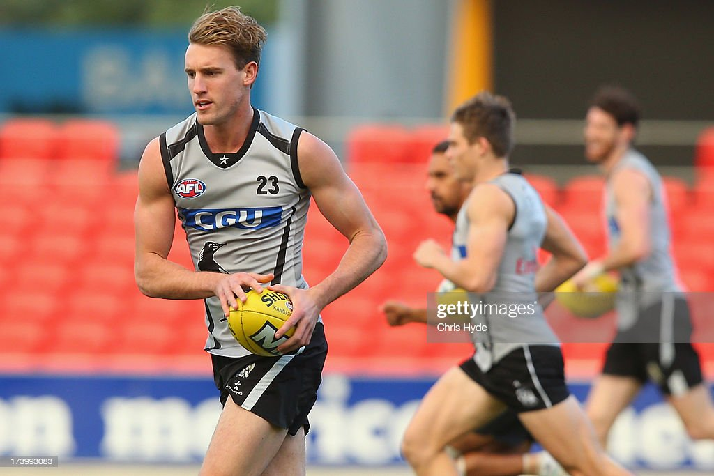 Lachlan Keeffe runs during a Collingwood Magpies AFL training session at Metricon Stadium on July 19, 2013 in Gold Coast, Australia.