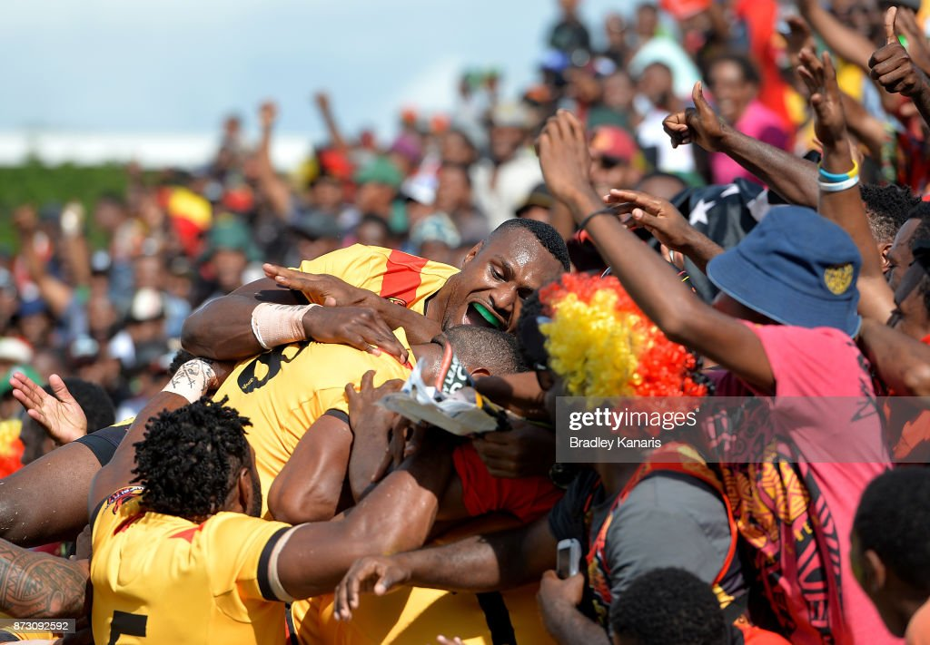 Lachlan Lam of Papua New Guinea is congratulated by team mates after scoring a try during the 2017 Rugby League World Cup match between Papua New Guinea and the United States on November 12, 2017 in Port Moresby, Papua New Guinea.