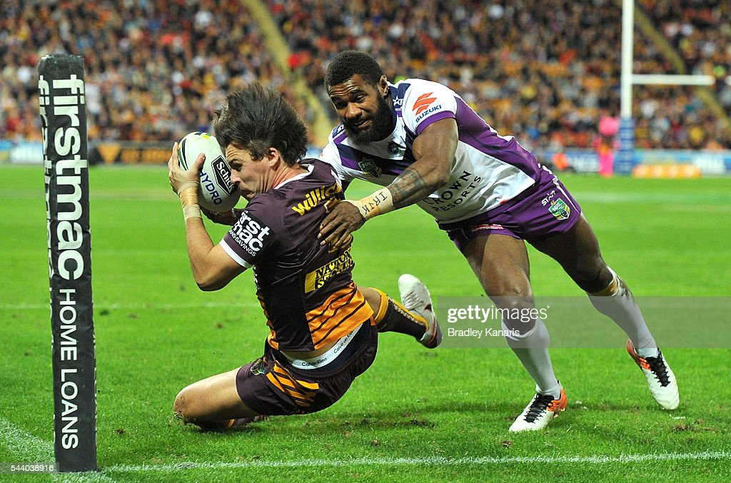 Lachlan Maranta of the Broncos is prevented from scoring a try by the defence of Marika Koroibete of the Storm during the round 17 NRL match between the Brisbane Broncos and the Melbourne Storm at Suncorp Stadium on July 1, 2016 in Brisbane, Australia.