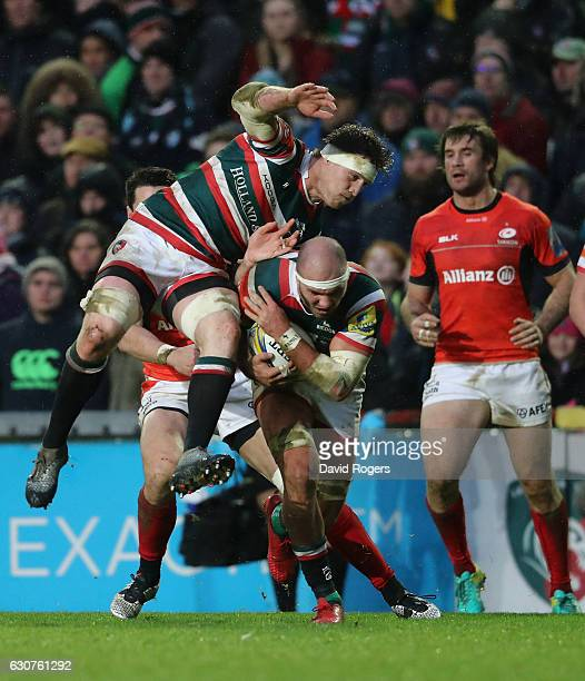 Lachlan McCaffrey of Leicester holds onto the ball despite colliding into team mate Brendon O'Connor during the Aviva Premiership match between...
