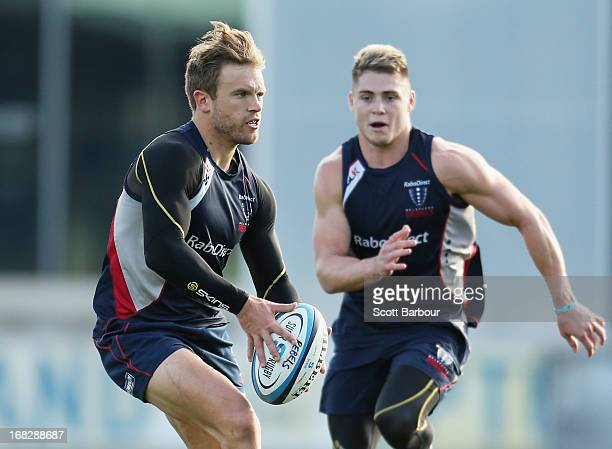 Lachlan Mitchell and James O'Connor of the Rebels run with the ball during a Melbourne Rebels Super Rugby training session at Visy Park on May 8 2013...