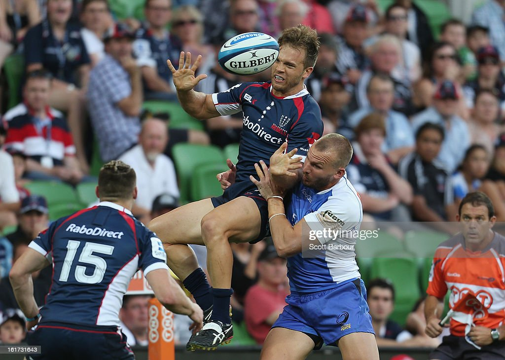 Lachlan Mitchell of the Rebels is tackled during the round one Super Rugby match between the Rebels and the Force at AAMI Park on February 15, 2013 in Melbourne, Australia.