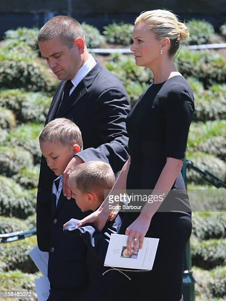 Lachlan Murdoch and Sarah Murdoch walk with their children Kalan and Aidan as they leave after attending the Dame Elisabeth Murdoch public memorial...