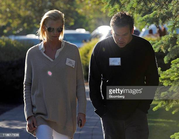 Lachlan Murdoch chairman and chief executive officer of Illyria Pty Ltd right walks with Sarah Murdoch at the Allen Co Media and Technology...