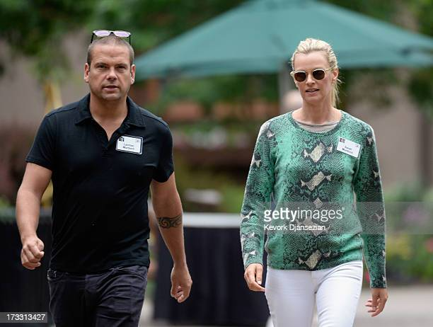 Lachlan Murdoch son of media mogul Rupert Murdoch and executive of Illyria Property Limited and his wife Sarah Murdoch attend the Allen Co annual...