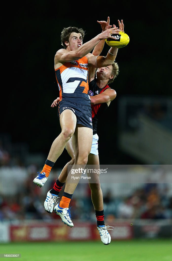 Lachlan Plowman of the Giants marks over Martin Gleeson of the Bombers during the round three of the NAB Cup AFL match between the Greater Western Sydney Giants and the Essendon Bombers at Manuka Oval on March 8, 2013 in Canberra, Australia.