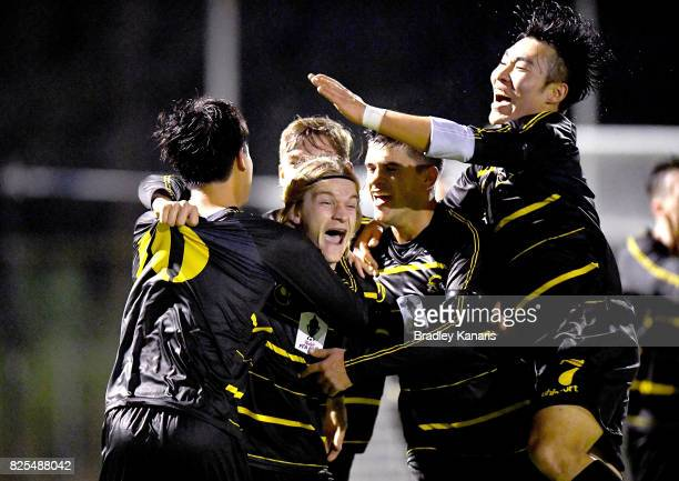 Lachlan Strogusz of Moreton Bay is congratulated by team mates after scoring a goal during the FFA Cup round of 32 match between Moreton Bay United...