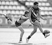 Lachlan Tiziani of NSW/ACT chases Jamie Hampton of Northern Territory during the U18 Championships match between NSW/ACT and Northern Territory at...